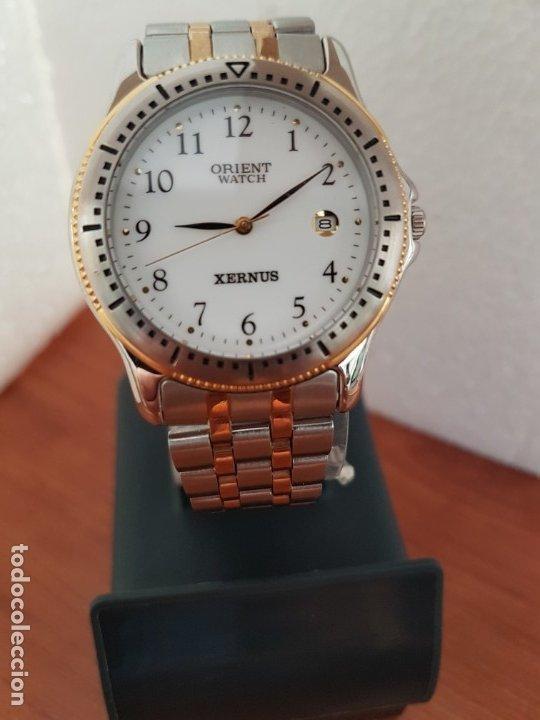 Relojes: Reloj de caballero ORIENT cuarzo acero y oro, esfera blanca, calendario las tres, correa acero oro. - Foto 10 - 178651967