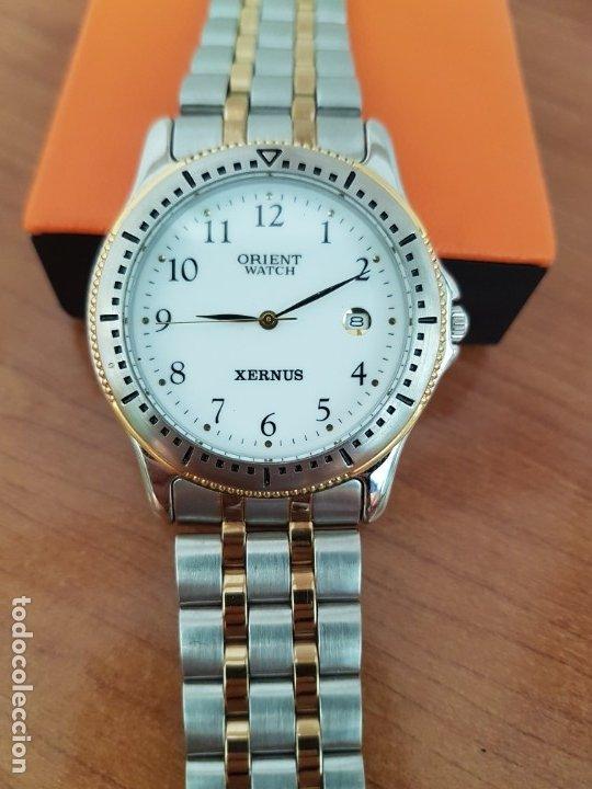 Relojes: Reloj de caballero ORIENT cuarzo acero y oro, esfera blanca, calendario las tres, correa acero oro. - Foto 11 - 178651967