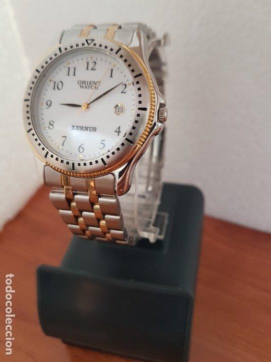 Relojes: Reloj de caballero ORIENT cuarzo acero y oro, esfera blanca, calendario las tres, correa acero oro. - Foto 16 - 178651967