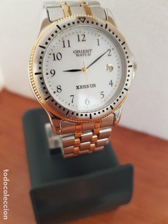 Relojes: Reloj de caballero ORIENT cuarzo acero y oro, esfera blanca, calendario las tres, correa acero oro. - Foto 18 - 178651967