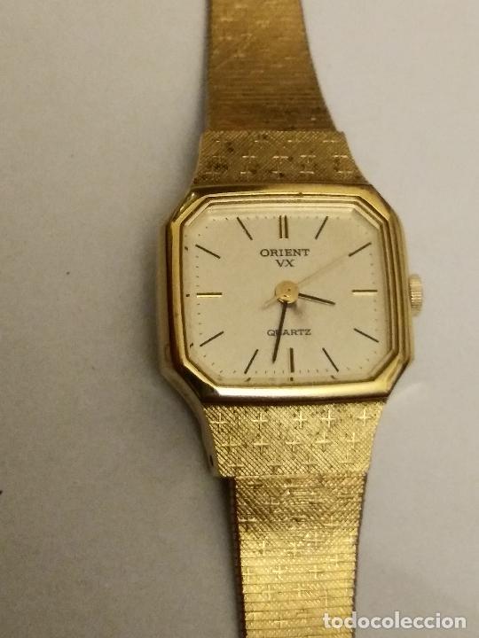 Relojes: RELOJ ORIENT DORADO NUEVO A ESTRENAR CON CADENITA EN CIERRE - Foto 2 - 229353665