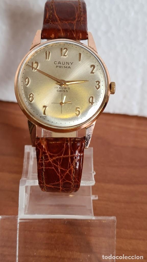 RELOJ UNISEX (VINTAGE) CAUNY PRIMA CHAPADO ORO 10 MICRAS DE CUERDA, 17 RUBIS, CORREA CUERO MARRÓN. (Relojes - Relojes Actuales - Otros)