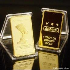 Reproducciones billetes y monedas: AFRICA LINGOTE ORO 24 KILATES 43 GRAMOS, HOMENAJE A CLEOPATRA REINA DEL ANTIGUO EGIPTO. Lote 260604050