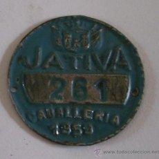 Coches y Motocicletas: CHAPA TASA DE RODAJE, CABALLERIA 261, JATIVA 1959 (3,5CM APROX, SEÑALES DE EDAD). Lote 31944920