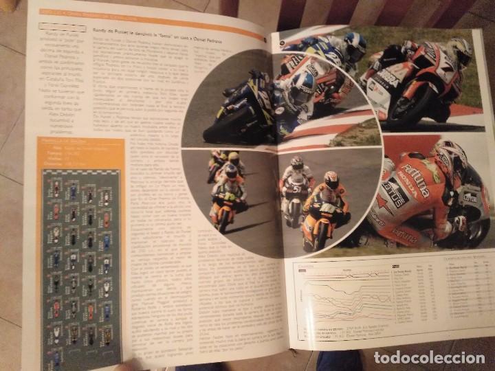 Coches y Motocicletas: ESPECTACULAR Y GRAN TOMO GG.PP. MOTOCICLISMO 2004 CAMPEONES DEL MUNDO 125,250 MOTO GP,MICHELIN... - Foto 23 - 142240762