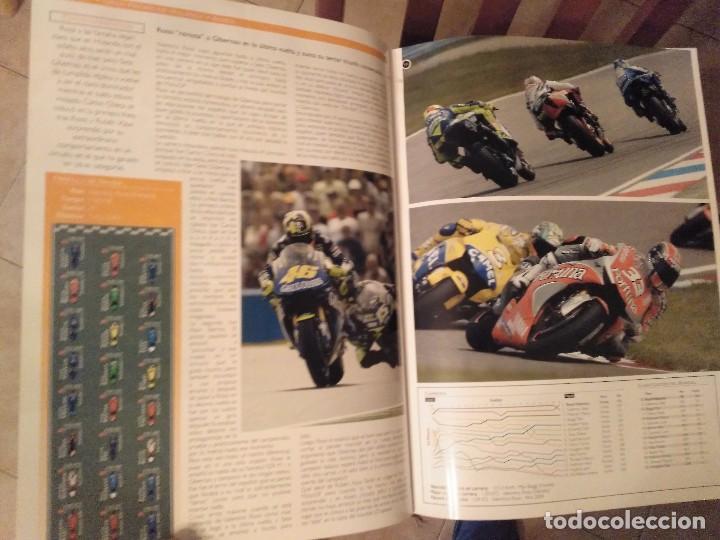 Coches y Motocicletas: ESPECTACULAR Y GRAN TOMO GG.PP. MOTOCICLISMO 2004 CAMPEONES DEL MUNDO 125,250 MOTO GP,MICHELIN... - Foto 26 - 142240762