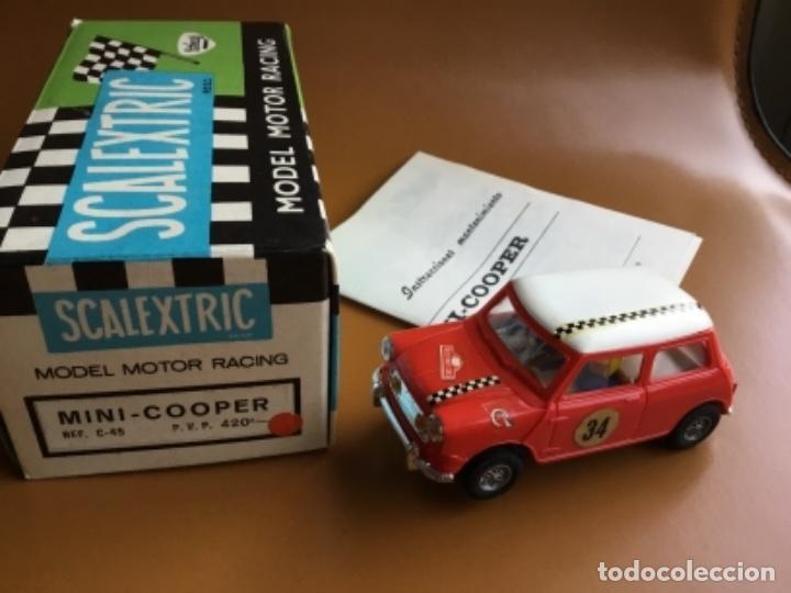 SCALEXTRIC EXIN. MINI COOPER ROJO CLARO . CON CAJA E INSTRUCCIONES . CASCO ABIERTO. MUY BUENO. (Juguetes - Slot Cars - Scalextric Exin)