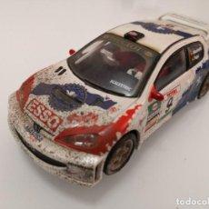 Scalextric: SCALEXTRIC. PEUGEOT 206 WRC - EFECTO BARRO. REF. 6051 MUNIENTE. Lote 207456690