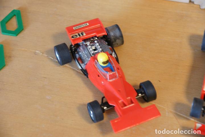 Scalextric: Scalextric GP-16. 3 coches + 2 mandos + 17 pistas + fuente de alimentación + caja bien conservada. - Foto 9 - 230688090