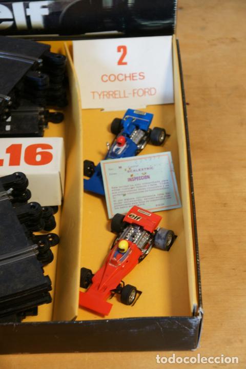 Scalextric: Scalextric GP-16. 3 coches + 2 mandos + 17 pistas + fuente de alimentación + caja bien conservada. - Foto 17 - 230688090