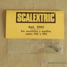 Scalextric: SCALEXTRIC. PAR ESCOBILLAS Y MUELLES MOTOR RX2 Y RX3. REF. 5162. EN BOLSA SIN ESTRENAR.. Lote 37096308