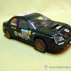 Scalextric: SLOT CAR SCALEXTRIC, SUBARU IMPREZA WRC ,FUNCIONANDO, SE ENCIENDEN LAS LUCES, CON FALTAS, . Lote 24973251