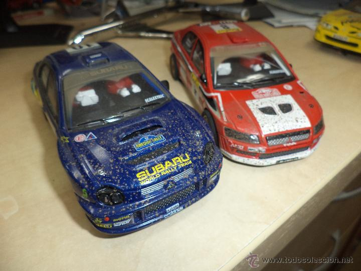 LOTE 2 COCHES SCALEXTRIC TECNITOYS EFECTO BARRO.SUBARU IMPREZA Y MITSUBISHI LANCER. (Juguetes - Slot Cars - Scalextric Tecnitoys)