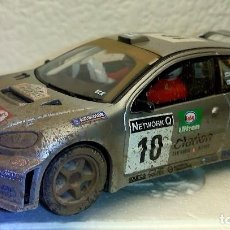 Scalextric: SCALEXTRIC PEUGEOT 206 WRC EFECTO BARRO GRONHOLM **NUEVO**. Lote 109593387