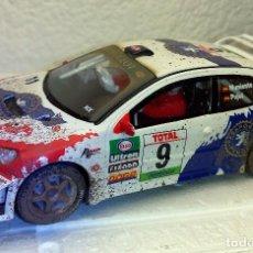 Scalextric: SCALEXTRIC PEUGEOT 206 WRC EFECTO BARRO MUNIENTE-PUJOL **NUEVO**. Lote 109594935