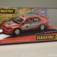 Scalextric: NUEVO A ESTRENAR COCHE SCALEXTRIC RALLY SLOT FLY TEAMSLOT MITSUBISHI LANCER EVO VII WRC HAKKINEN. Lote 118757127