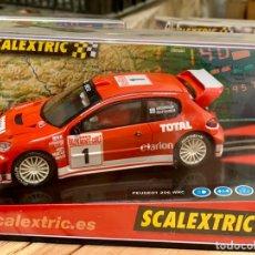 "Scalextric: SCALEXTRIC COCHE NUEVO PEUGEOT 206 WRC ""GRÖNHOLM"". Lote 167834368"