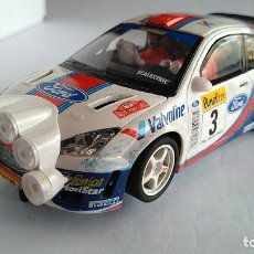 Scalextric: SCALEXTRIC FORD FOCUS WRC 4X4 CON LUCES CARLOS SAINZ. FUNCIONA. Lote 208926860