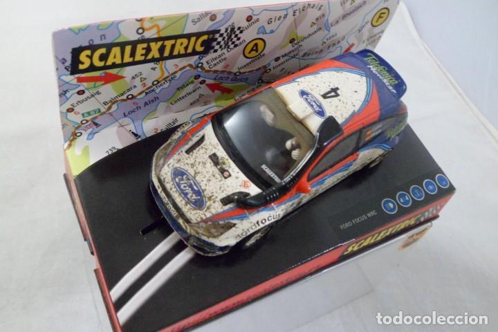 SLOT CAR SCALEXTRIC FORD FOCUS WRC SAFARI EFECTO BARRO Nº4 REF. 6106 SAINZ / MOYA (Juguetes - Slot Cars - Scalextric Tecnitoys)