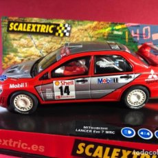 Scalextric: MITSUBISHI LANCER EVO 7 WRC, DE SCX. Lote 218094035