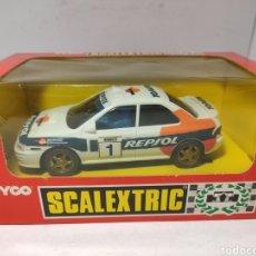 Scalextric: SCALEXTRIC SUBARU IMPREZA REPSOL CON LUZ 4X4 TYCO REF. 8376. Lote 245157945