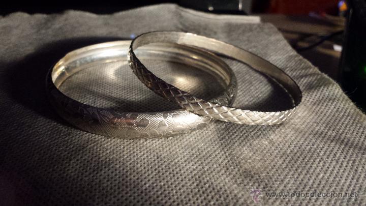 039b55b05ca1 conjunto de tres pulseras de metal plateadas gr - Buy Second Hand ...