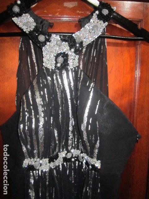 d031dc8e1 Vestido de fiesta negro y plata, con pedrería. Marca Allure. Talla 40