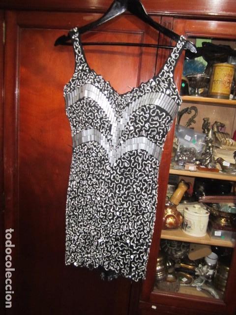 ef988f7b0 Vestido de fiesta corto, con pedrería, de Jorge Terra. Talla 40. Es  elástico.