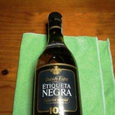 Segunda Mano: BOTELLA DE BRANDY 103 ETIQUETA NEGRA. MUY BIEN CONSERVADA.. Lote 229727105