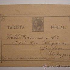 Sellos: RARO ENTERO POSTAL ALFONSO XII 10 CENTIMOS AÑO 1883 CIRCULADO A PORTUGAL. Lote 34032667