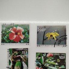 Sellos: 4 SELLOS CON FLORES REPUBLICA DE COMORES. Lote 221637186