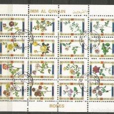 Sellos: UMM AL QIWAIN - BLOQUE DE 16 SELLOS DE ROSAS 1973 - SELLADO. Lote 236247085