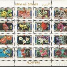 Sellos: UMM AL QIWAIN - BLOQUE DE 16 SELLOS DE FLORES DIFERENTES - 1973 - SELLADO. Lote 236414400