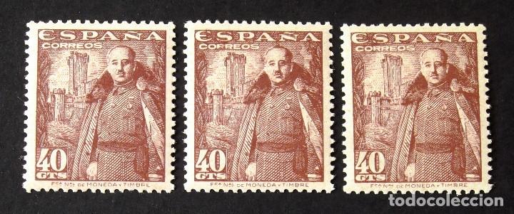 1027A, TRES SELLOS NUEVOS, SIN CH., COLOR CASTAÑO OSCURO. MOTA. (Sellos - España - Estado Español - De 1.936 a 1.949 - Nuevos)