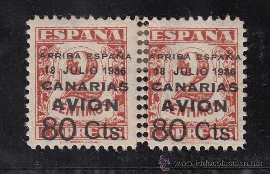 ,,CANARIAS 21 PAREJA CON CHARNELA, SOBRECARGADO, VARIEDAD DOBLE PERFORACION CENTRAL VERTICAL (Sellos - España - Guerra Civil - Beneficencia)