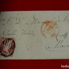 Sellos: CARTA (ENVUELTA) NOVES TOLEDO FECHADOR TIPO I ROJO A MADRID PARRILLA NEGRO. Lote 77602601