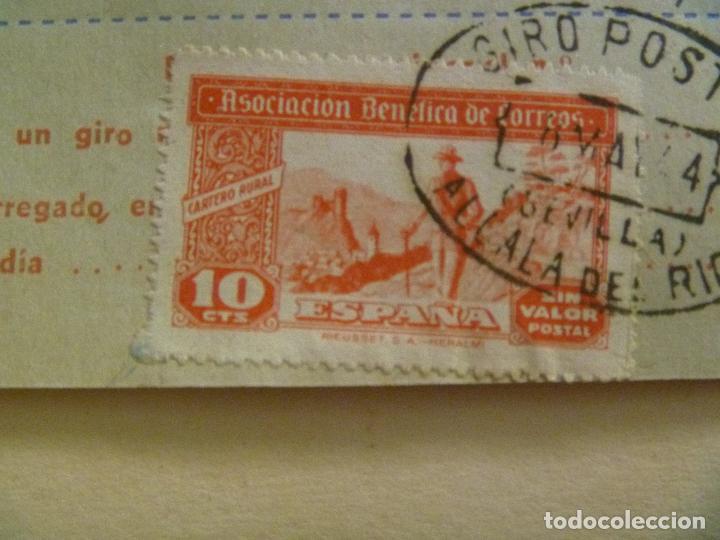 Sellos: VIÑETA DE LA ASOCIACION BENEFICA DE CORREOS EN UN RECIBO DE GIRO. ALCALA DEL RIO, SEVILLA, 1944 - Foto 2 - 99568223