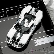 Slot Cars: CAJA FORD GT 40 LIM Y NUM CATALOGO 2004. Lote 31189830