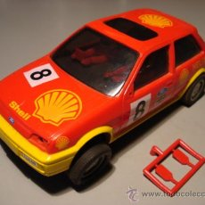 Slot Cars: HORNBY HOBBIES COMPATIBLE SCALEXTRIC FORD FIESTA SHELL. Lote 26266462