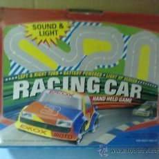 Slot Cars: RACING CAR GRAND PRIX,BATTERY POWER HAND HELD GAME (FUNCIONA). Lote 29445895