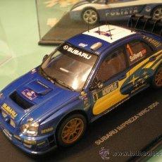 Slot Cars: SCALEXTRIC SUBARU IMPREZA WRC 2004 1/24 NUEVO EN CAJA. Lote 35153759