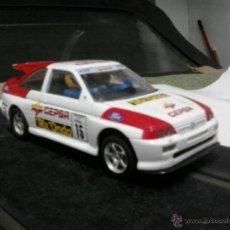 Slot Cars: FORD ESCORT RALLY -CEPSA-MADE IN ENGLAND-HORNBY HOBBIES LTD. Lote 39844240