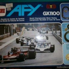 Slot Cars: SCALEXTRIC COMANSI AFY GX1100 CON 2 COCHES ORIGINALES Y 2 MAS COMPATIBLES BUEN ESTADO. Lote 57304208