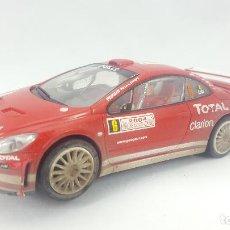 Slot Cars: COCHE SLOT - CARRERA EVOLUTION - PEUGEOT 307 WRC EFECTO BARRO. Lote 121872807