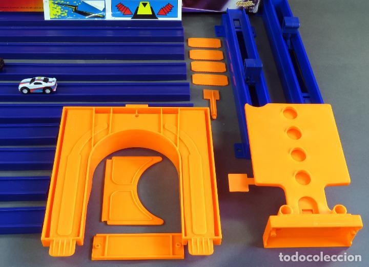 Slot Cars: Micromachines pista Radicators Rapid Paraca caja Ref 74630 con dos coches - Foto 4 - 183915628
