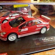 Slot Cars: ANTIGUO COCHE DE RALLY SLOT CARRERA PEUGEOT 307 WRC MONTECARLO 2004 EN SU CAJA - SCALEXTRIC SCX. Lote 267333279