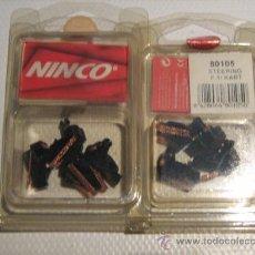 Slot Cars: NINCO. 2 PAQUETES DE 4 GUIAS F-1/KART (8 GUIAS ). Lote 175563330