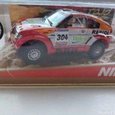 Slot Cars: COCHE SCALEXTRIC DE NINCO MITSUBISHI PAJERO EVO DAKKAR 2006 REF. 50390. Lote 213055690