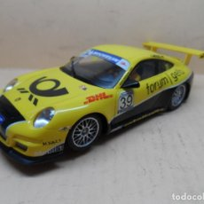 Slot Cars: SCALEXTRIC NINCO PORSCHE 997 AMARILLO DHL 50445. Lote 263285425