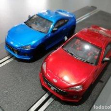 Slot Cars: NOVEDAD - LOS 2 SUBARU BRZ AZUL Y ROJO DE POLICAR. Lote 202889476